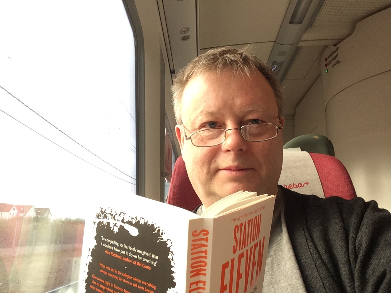 Jan reading on the train